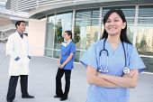 image of medical assistant  - A happy and successful medical team outside hospital building - JPG