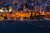 Aerial View Of Limassol Cityscape, First Coastline Buildings In Cyprus At Night. Drone Photo Of Medi poster