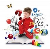 stock photo of math  - A young boy is sitting on a big with different science - JPG