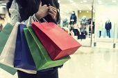 Crop Unrecognizable Girl Clasping Many Shopping Bags On Mall Background. Lady Making Many Purchases  poster