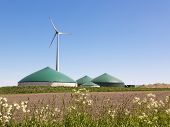 stock photo of biogas  - Biogas plant and wind turbine in rural Germany - JPG