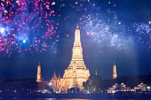 Exotic New Year - Celebrating the New Year in Bangkok with fireworks at Wat Arun Temple, Bangkok, Th poster