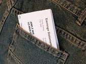 stock photo of paycheck  - paycheck in back pocket of jeans - JPG