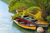 Empty Old Colorful Fishing Boats Docked On Sea Water. Traditional Countryside Nature Scene On The Ri poster