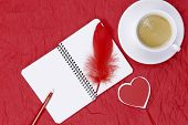 On Crumpled Red Paper Lies A Notebook, Red Pen, Red Bird Feather, Red Heart And A White Cup With Cof poster