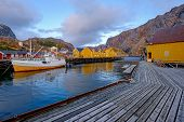Nusfjord, Authentic Fishing Village With Traditional Yellow And Red Fishing Houses Rorbu, Lofoten Is poster