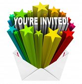 The words You're Invited in a burst of stars in an open envelope as an invitation to a party or othe