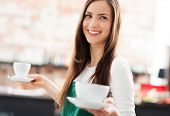 stock photo of apron  - Waitress serving coffee - JPG