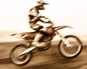 Extreme sport, slow motion on motorbike, pro race driver jumping on the dirt bike, motocross, speed