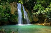 stock photo of swimming  - waterfall in deep green forest - JPG