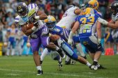 VIENNA, AUSTRIA - JUNE 2: RB Kenneth Chinaemelu (#35 Vikings) is tackled by LB Alex Gross (#37 Giant