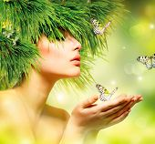 Spring Woman. Beauty Summer Girl with Grass Hair and Green Makeup. Butterflies. Nature Style.  Envir