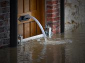 image of flood  - River water being pumped out of flooded house - JPG