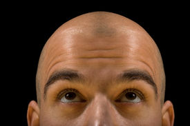picture of bald headed  - Bald man head looking up thinking with focus on eyes - JPG