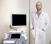 stock photo of ultrasound machine  - Portrait of young male technician operating ultrasound machine in white dress - JPG