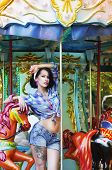 image of funfair  - Merry-go-round. Playful Stylish Showy Woman in Roundabout. Funfair