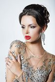 Elegance. Luxurious Good Looking Woman In Dress With Sequins And Jewels