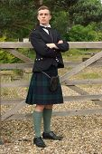stock photo of kilts  - A handsome young Scotsman in a kilt and full dress outfit - JPG
