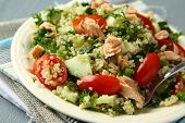 stock photo of quinoa  - Tabbouleh salad with quinoa salmon tomatoes cucumbers and parsley - JPG