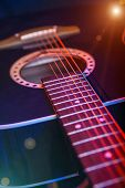 stock photo of soffit  - acoustic Guitar on a bright background closeup - JPG