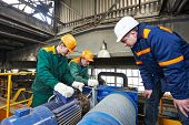image of assemblage  - industrial workers with spanner at factory construction workshop - JPG