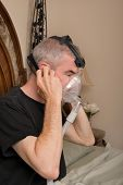 foto of cpap machine  - Man wearing his CPAP machine before sleeping - JPG
