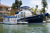 pic of dingy  - Beautiful boat moored outside the back yard of a waterfront house in Newport Beach - JPG