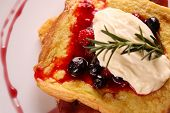 foto of french toast  - Delicious french toast with bacon syrup berries and cream on a white plate on a wooden table - JPG