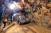 picture of dungeon  - Railroad mine tunnel in a dark underground - JPG
