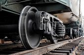 stock photo of train-wheel  - A closeup view of the wheels of a train - JPG