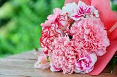 stock photo of carnations  - carnation bouquet on garden table for gift - JPG