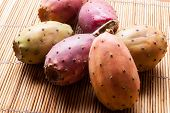 pic of prickly-pear  - red prickly pears on a bamboo placemat