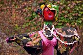 foto of scarecrow  - Creative scarecrow in shape of woman in a countryside garden - JPG