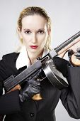 image of tommy-gun  - Mafia style fashion studio portrait  - JPG
