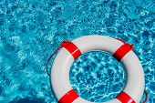 pic of crisis  - an emergency tire floating in a swimming pool - JPG