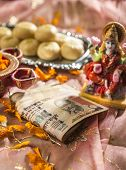 pic of laxmi  - A bunch of thousand rupees indian note in Diwali Puja set up - JPG