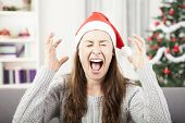 stock photo of reaction  - young girl screams because of bad christmas stress - JPG