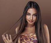 pic of mulatto  - cute happy young indian woman in studio close up smiling - JPG