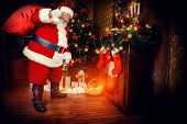 stock photo of christmas wreath  - Santa Claus brought gifts for Christmas - JPG