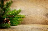 picture of solemn  - Wooden christmas background with spruce with pine cone - JPG
