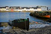 stock photo of claddagh  - broken ice on the bank of Corrib river and boats in Claddah Galway - JPG