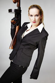 """image of tommy-gun  - Mafia style fashion studio portrait - nice young woman posing with """"Tommy"""" gun for figure and portrait photos in retro criminal style. ** Note: Soft Focus at 100%, best at smaller sizes - JPG"""