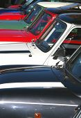stock photo of mg  - Classic MG mini motorcars of different colors all parked in a row - JPG