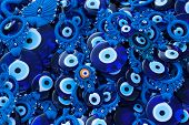 pic of glass-wool  - Blue glass eye on a pile as background - JPG