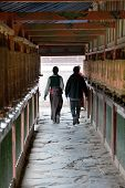 stock photo of tibetan  - Tibetan people and prayer wheels Labrang monastery Xiahe China - JPG