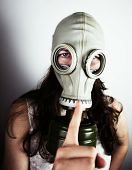 picture of rubber mask  - Woman wearing gas mask close - JPG