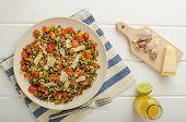 foto of vegetarian meal  - Warm salad of lentils bio healthy diet food vegetarian parmesan shavings and microgreens - JPG