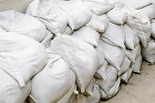 stock photo of sandbag  - sandbags for flood defense or military use - JPG
