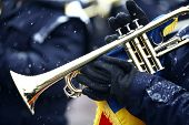 stock photo of trumpets  - Color image of a trumpet being played on a snowy day - JPG