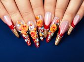 picture of nail-design  - Art design female nails on blue background - JPG